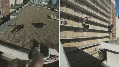 Daredevils leap between high rises in dangerous stunt