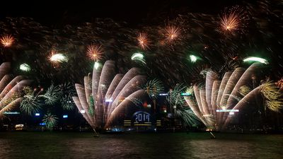 Hong Kong's Victoria Harbour was illuminated by fan-like fireworks as the clock struck midnight. (AAP)
