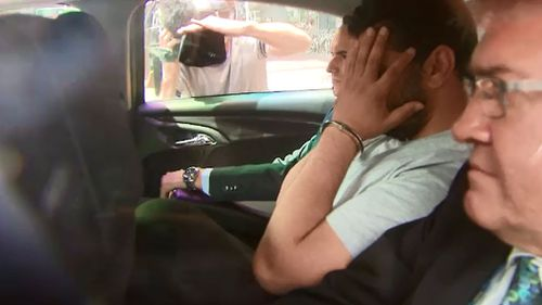Saeed Noori is transported by police. (9NEWS)