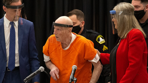 In this June 29, 2020, file photo, Joseph James DeAngelo, center, charged with being the Golden State Killer, is helped up by his attorney, Diane Howard, as Sacramento Superior Court Judge Michael Bowman enters the courtroom in Sacramento, Calif.  (AP Photo/Rich Pedroncelli, File)