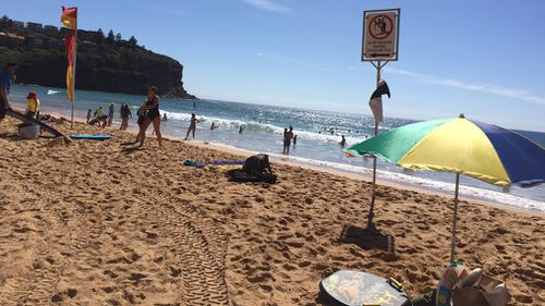 Swimmers take a dip and cool off in Bilgola Beach on Sydney's north. (Picture: Josie MacRae)