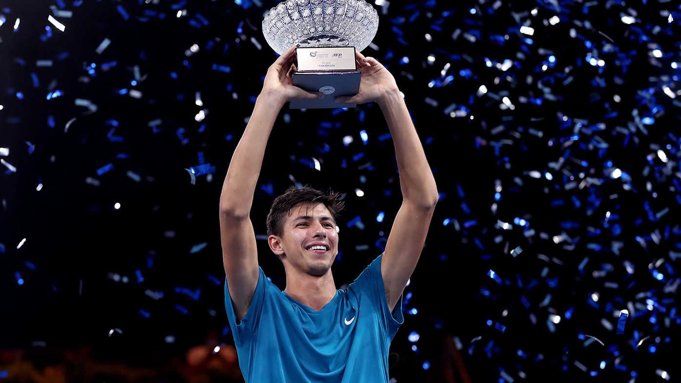 Alexei Popyrin of Australia holds the winner's trophy after his victory in Men's Singles Final match against Alexander Bublik of Kazakhstan on day seven of the Singapore Tennis Open