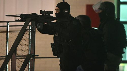 Police are seen during the operation in Reims. (Getty)