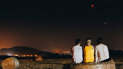 Viewers watching a lunar eclipse in Spain.