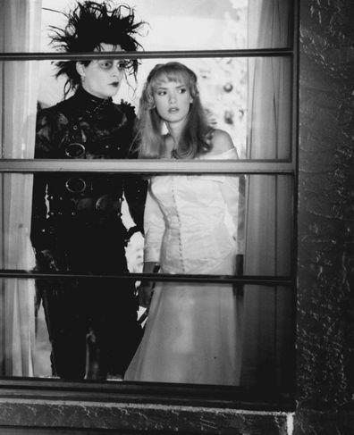 "Edward Scissorhands set photo Johnny Depp is ""Edward Scissorhands,"" and Winona Ryder is Kim Boggs"