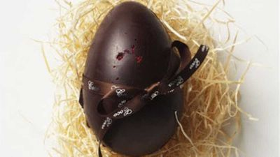 """<p>For something truly decadent and egg-ceptional (yes, we went there), <a href=""""http://cocochocolate.com.au/shop/gifts/easter/coco-organic-dark-chocolate-egg-with-raspberry/"""" target=""""_top"""" draggable=""""false"""">Coco Chocolate's organic dark chocolate egg with raspberry</a> is top of our list. It's sheer indulgence and comes in it's own little nest.</p> <p>RRP - $28.50 for a 12cm egg</p>"""