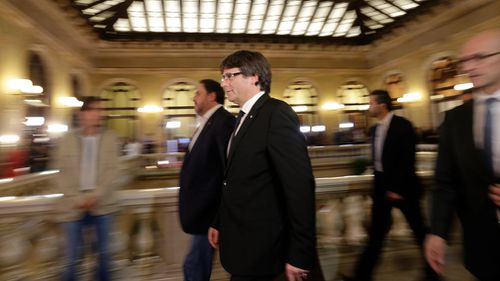Catalan regional President Carles Puigdemont walks into the Catalan parliament. (AP)