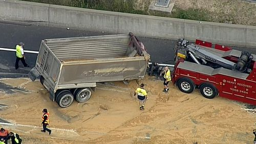 Truck rollover causes traffic delays on major road  in Sydney's west