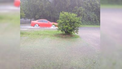 Minor flooding has affected roads through Burpengary. (Supplied: Kala Shaw)