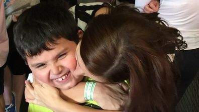 Jo Abi with her son Giovanni autism