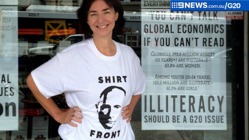 Avid Readers bookstore co-owner Fiona Stager wearing a Vladimir Putin parody t-shirt in Brisbane. (AAP)