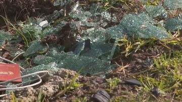 Parts of the shattered windscreen and debris remain at the scene of the horror double fatality.