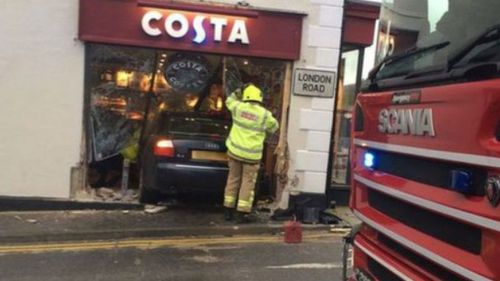 Woman killed as car crashes into UK coffee shop