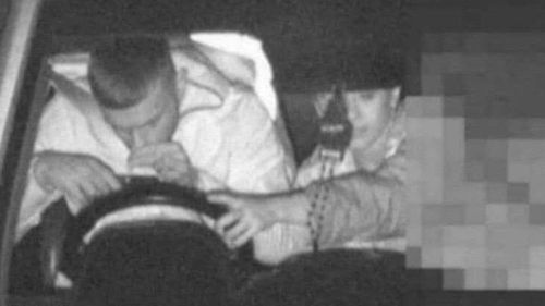 An image released by NSW Police allegedly shows a man using a mobile phone while driving.