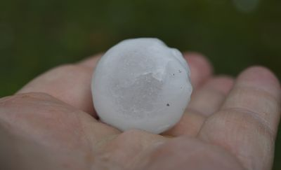Hail stones as large as 50 cent pieces fell across the city.