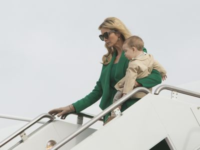 Ivanka Trump, who many have suggested will play more of a First Lady role than her step-mother, bucked with tradition and wore an emerald green outfit by Oscar De La Renta, which ensured she stood out in what was otherwise a sea of black. Her most lovely accessory - toddler son Theodore James.