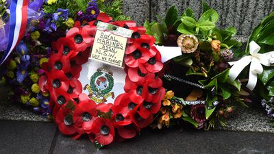 A wreath of poppies from the Royal Marines Association of NSW is left at the Martin Place Cenotaph. (AAP)