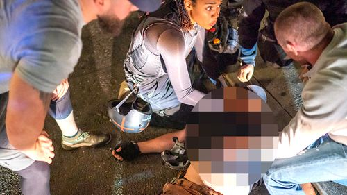 Sierra Boyne and protesters helped to treat Aaron J. Danielson, who was shot near a pro-Trump rally on August 29, 2020 in Portland, Oregon.