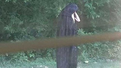 Creepy cloaked figure 'who dropped meat near playground' spooks US town