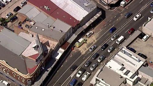 Fuel spills on major Sydney road after truck ruptures tank in median strip crash