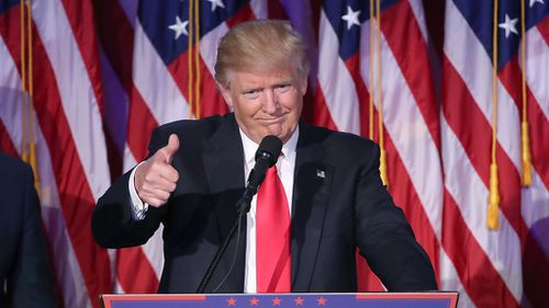 Republican president-elect Donald Trump gives a thumbs up during his acceptance speech on November 9, 2016 in New York City. (AFP)