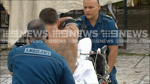 He was shown dramatically ripping off medical equipment before being tackled to the ground and wheeled away on a stretcher. (9NEWS)