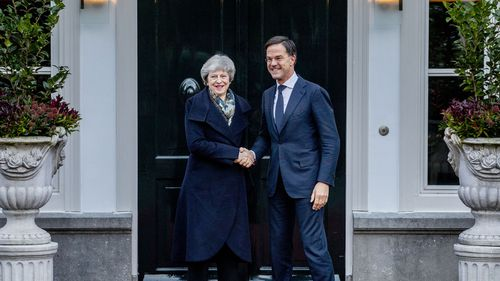 British Prime Minister Theresa May is greeted by Dutch Prime Minister Mark Rutte upon her arrival in The Hague, Netherlands.