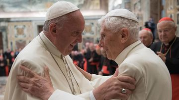 Pope Francis, left, and retired Pope Benedict XVI embrace during a ceremony to celebrate Benedict's 65th anniversary of his ordination as a priest