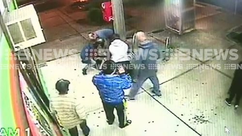 Quick-thinking witnesses bring the man to the ground and hold him down with a shopping trolley.