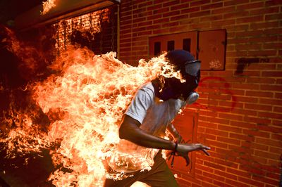 <p>The World Press Photo Foundation has announced the nominees for its 2018 awards.&nbsp;</p> <p>Two Australian photographers - Adam Ferguson and Patrick Brown - have been shortlisted for the World Press Photo of the Year. Just six photographs were nominated for the 10,000 euro prize.</p> <p>The winning photo will be announced on April 12 in Amsterdam.</p> <p>See the nominees and a selection from the other categories here. <strong>WARNING: Graphic images follow.</strong></p> <p><strong>THE SIX NOMINEES FOR WORLD PRESS PHOTO OF THE YEAR</strong><br /> <br /> Venezuela Crisis</p>