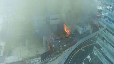 Flames and smoke burst forth from the construction site. (Jess Dyas)