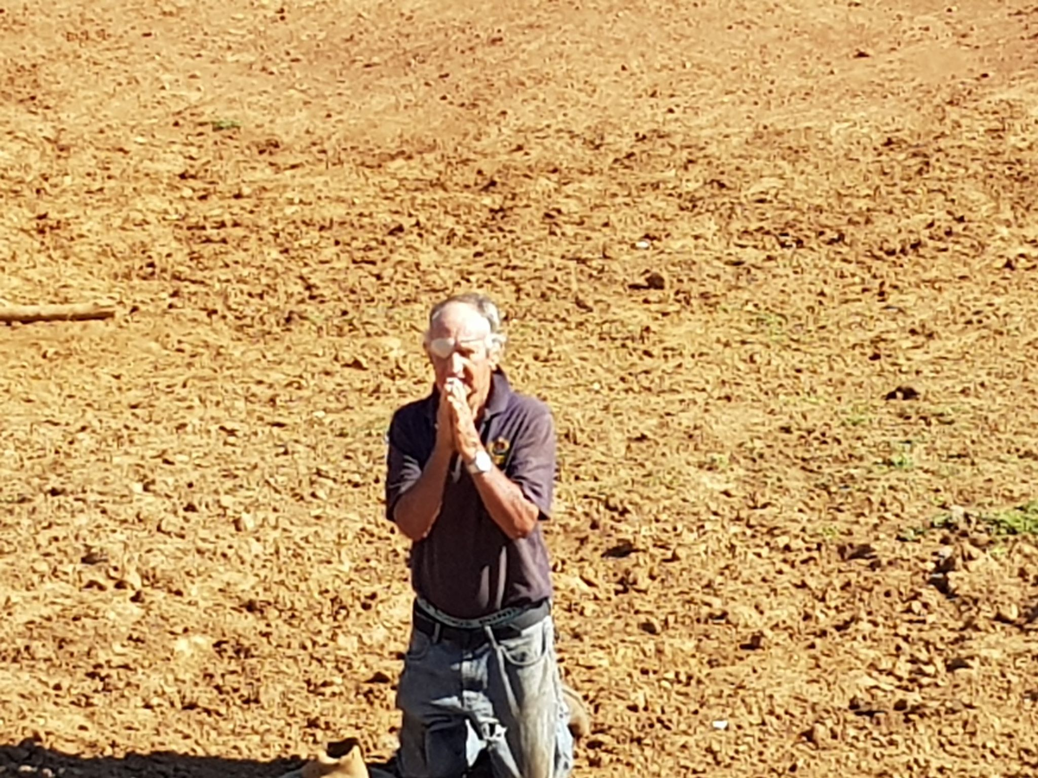 November 2018 Alf King was photographed praying for rain in a dry dam.