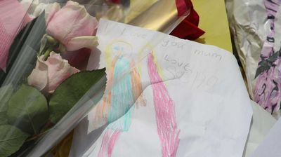 A note left by siege victim Katrina Dawson's child which reads 'I love you Mum. Love Sasha' sits beside tributes from friends and complete strangers at Martin Place.