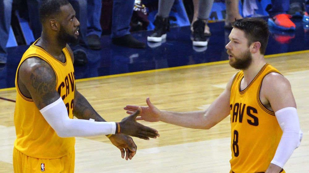 LeBron James (L) and Matthew Dellavedova. (AAP-file)