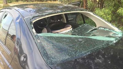 Damaged cars and broken windows were a common sight throughout Chinchilla after the freak storm passed. (Supplied/Terry O'Leary)