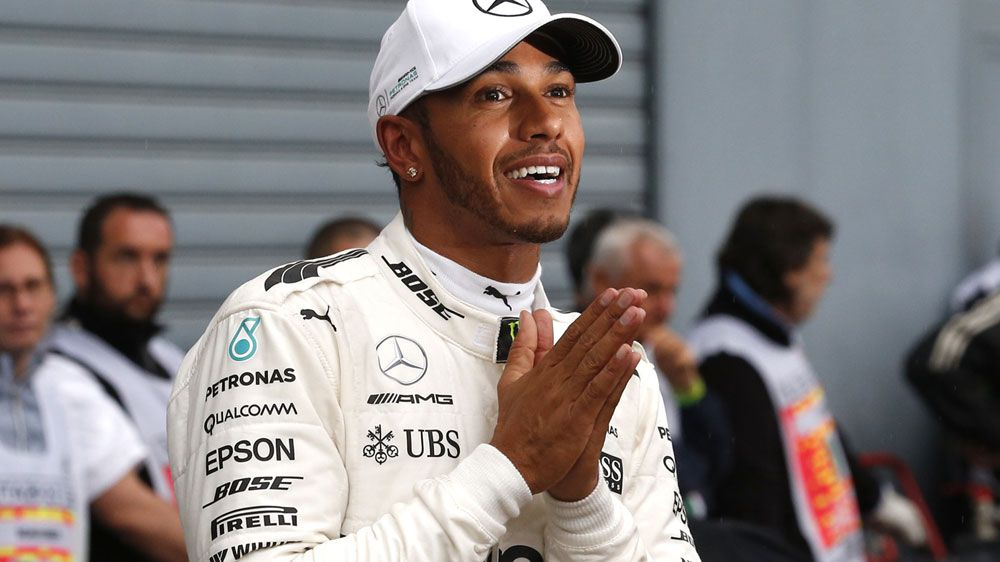Mercedes driver Lewis Hamilton takes record pole at Monza