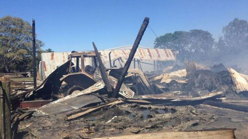 A farmer's shed destroyed by fire in Victoria's north-east. (Alexis Daish, 9NEWS)