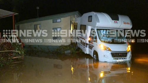 Forty-two people were rescued from a flooded Cairns caravan park. (9NEWS)