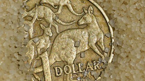 Australian dollar slides after hitting two-year high