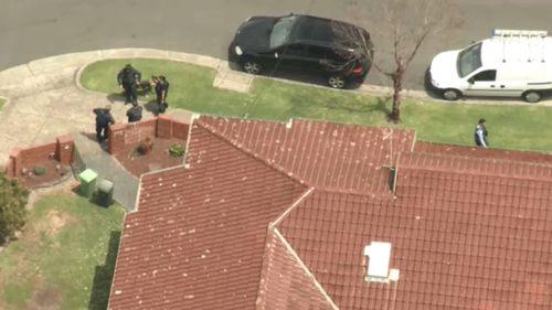 It's understood police located an imitation firearm inside the property.