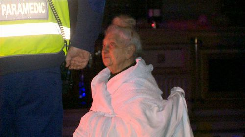 The elderly woman's son woke her and got her to safety about 2.15am. (9NEWS)