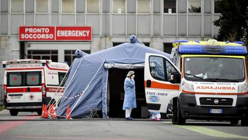 Paramedics stand by a tent that was set up outside the emergency ward of Cremona's hospital in northern Italy.