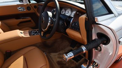 The interior is the height of style and luxury - An umbrella protrudes from its secret compartment in the door. (AAP)