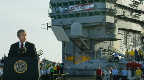 President George W Bush on board the aircraft carrier USS Abraham Lincoln in 2003.