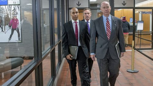 Former Minneapolis police officer Mohamed Noor, center, arrives for the first day of jury selection with his attorneys Peter Wold, left, and Thomas Plunkett, right, on Monday, April 1, 2019 at the Hennepin County Government Center in Minneapolis.