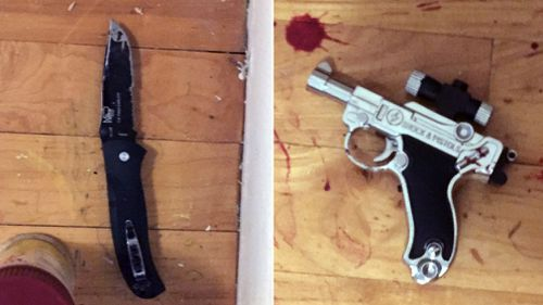 The knife and the fake gun police found after Richards was shot dead. (AAP)