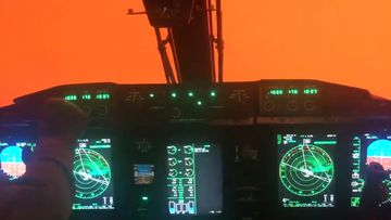 Video taken from inside an RAAF plane shows the challenging flying conditions pilots are facing, as they fly crucial support missions during the bushfire crisis.