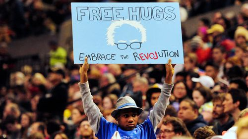 Devonte Hart holding up a sign as Democratic presidential candidate Bernie Sanders addressed the crowd during a rally.