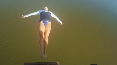 Rhiannan Iffland jumped backwards into the murky water below.