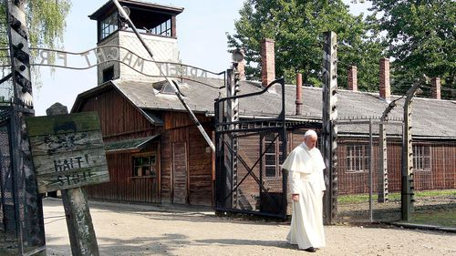 Pope Francis walks through the gate of the former Nazi German death camp of Auschwitz in Oswiecim, Poland. (AAP)